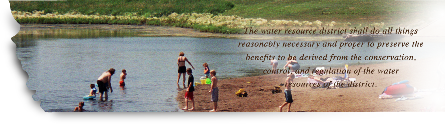 Photo of people at the shoreline enjoying the water, and the Burleigh County Water Resource District mission statement: The water resource district shall do all things reasonably necessary and proper to preserve the benefits to be derived from the conservation, control, and regulation of the water resources of the district.